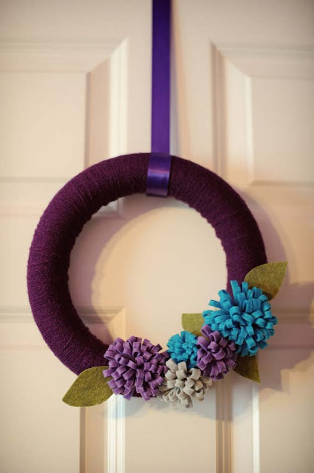 DIY Purple Room Decor - DIY Yarn Wreath with Felt Flowers- Best Bedroom Ideas and Projects in Purple - Cool Accessories, Crafts, Wall Art, Lamps, Rugs, Pillows for Adults, Teen and Girls Room http://diyprojectsforteens.com/diy-room-decor-purple