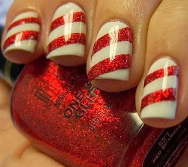 Cool DIY Nail Art Designs and Patterns for Christmas and Holidays -DIY Whoville Candy Cane Gloss Holiday Fingernails - Do It Yourself Manicure Ideas With Christmas Trees, Candy Canes, Snowflakes and Glittery Designs for Holiday Nails - Step by Step Tutorials and Instructions http://diyprojectsforteens.com/holiday-nail-art-patterns/