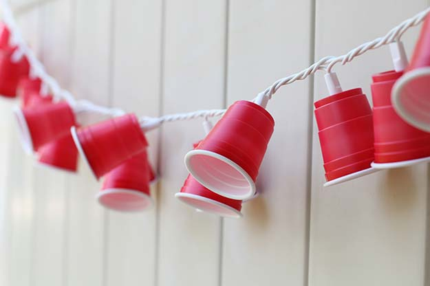 Cool Ways To Use Christmas Lights - DIY Party Cup Garland - Best Easy DIY Ideas for String Lights for Room Decoration, Home Decor and Creative DIY Bedroom Lighting - Creative Christmas Light Tutorials with Step by Step Instructions - Creative Crafts and DIY Projects for Teens, Teenagers and Adults http://diyprojectsforteens.com/diy-projects-string-lights