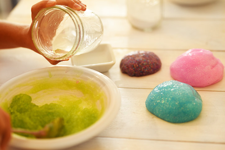 How To Make Rainbow Slime - Mix A Small Amount of Borax Water Into A Bowl, Then Stir - Cool and Easy Crafts for Kids and Teens - Ingredients and Step by Step Tutorial for Making Slime At Home - Cheap DIY Projects for Teens and Teenagers - Girls and Boys Love Making Slime