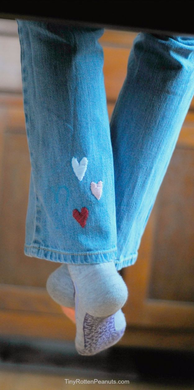 DIY Jeans Makeovers - Surprise Embroidered Hearts - Easy Crafts and Tutorials to Refashion and Upcycle Your Jeans and Create Ripped, Distressed, Bleach, Lace Edge, Cut Off, Skinny, Shorts, Skirts, Galaxy and Painted Jeans Ideas - Cool Denim Fashions for Teens, Teenagers, Women #diyideas #diyclothes #clothinghacks #teencrafts